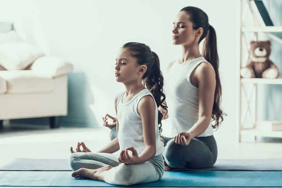 Two young ladies meditating
